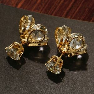 Gold tone crystal double sided earrings